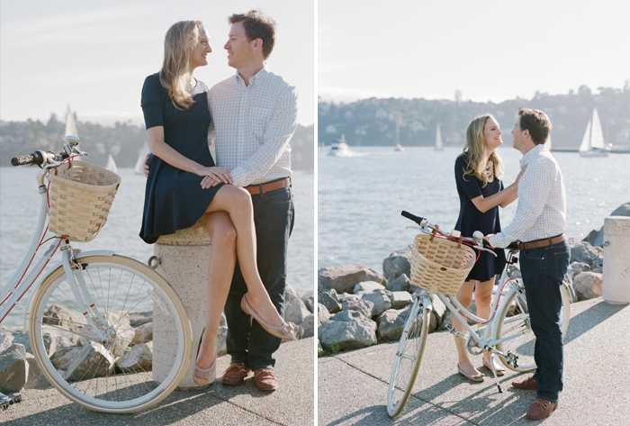 Couple gazes at one another on the edge of the sea in Tiburon  during an engagement session with Sylvie Gil.
