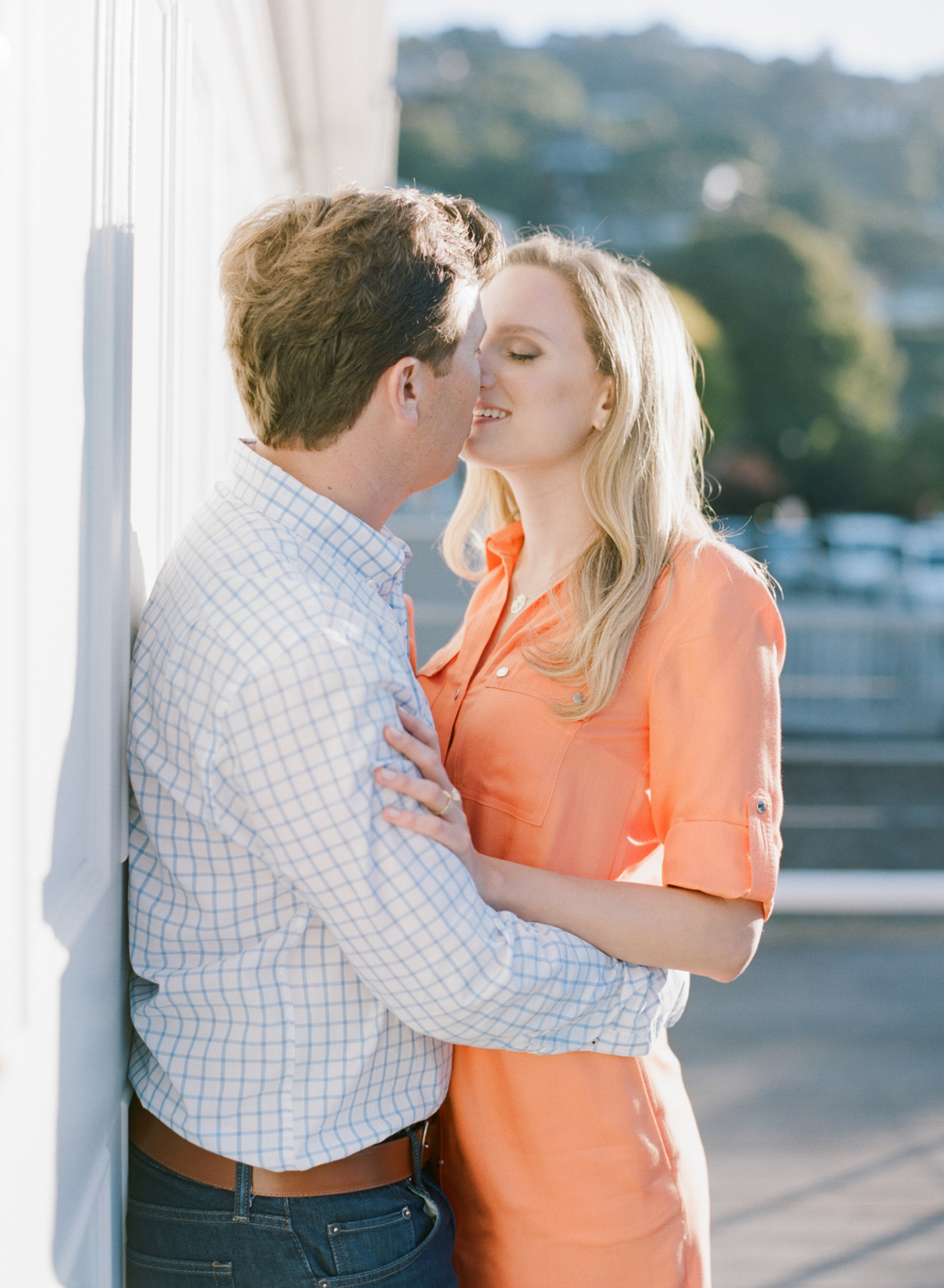 An intimate couple kisses in Tiburon  during an engagement session with Sylvie Gil.
