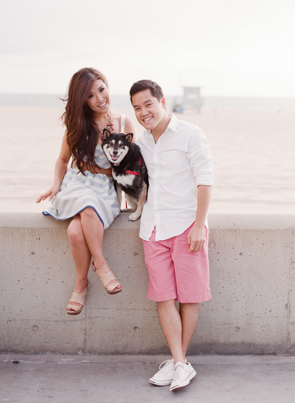 Couple with cute dog at their engagement session with Sylvie Gil at Hermosa Beach, California.