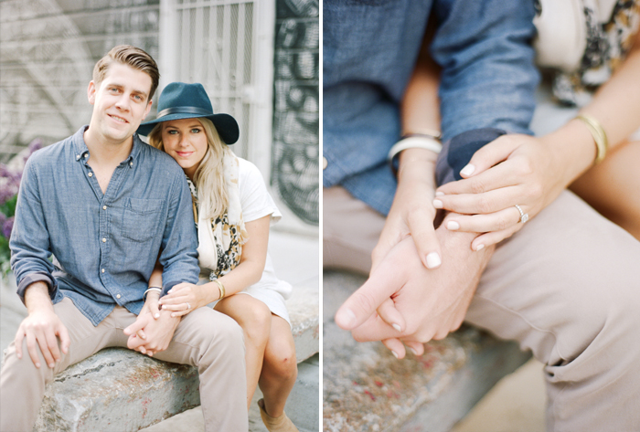 A couple shares an intimate moment holding hands in San Francisco during an engagement session with Sylvie Gil.