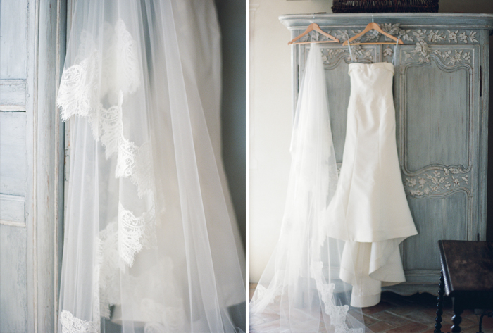 Sarah's Carolina Herrera dress hangs on the back of an antique armoire; photo by Sylvie Gil