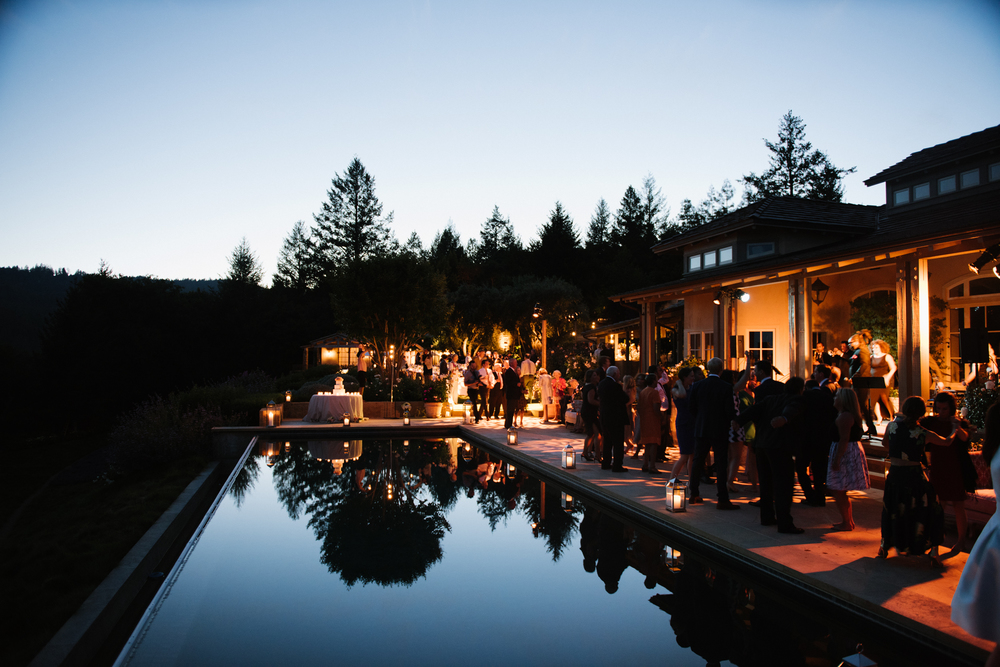 The dancing and merriment continues as the sun sets over the Napa estate with a party by the pool; photo by Sylvie Gil