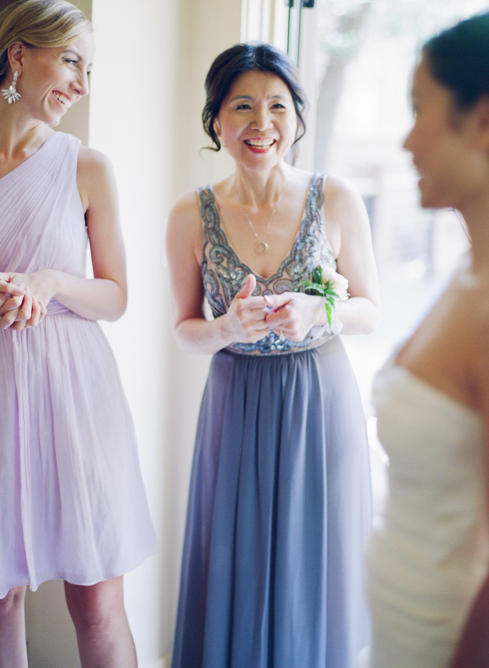 Mother of the bride admires her daughter before the Napa Valley ceremony; photo by Sylvie Gil