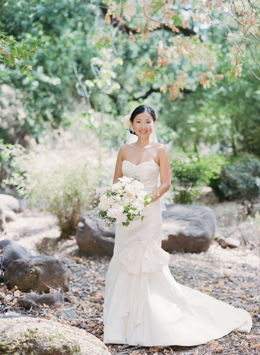 Di poses in a romantic woodsy setting, wearing an Oscar de la Renta gown; photo by Sylvie Gil