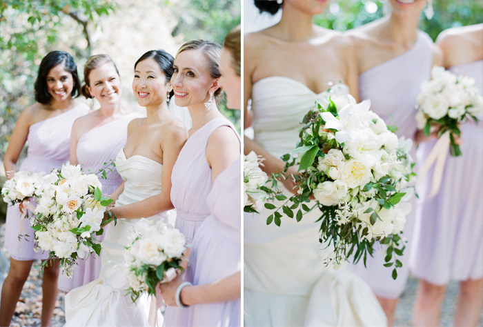 Bridesmaids wearing elegant lavender, one-shoulder gowns stand with the bride wearing an Oscar de la Renta; photo by Sylvie Gil