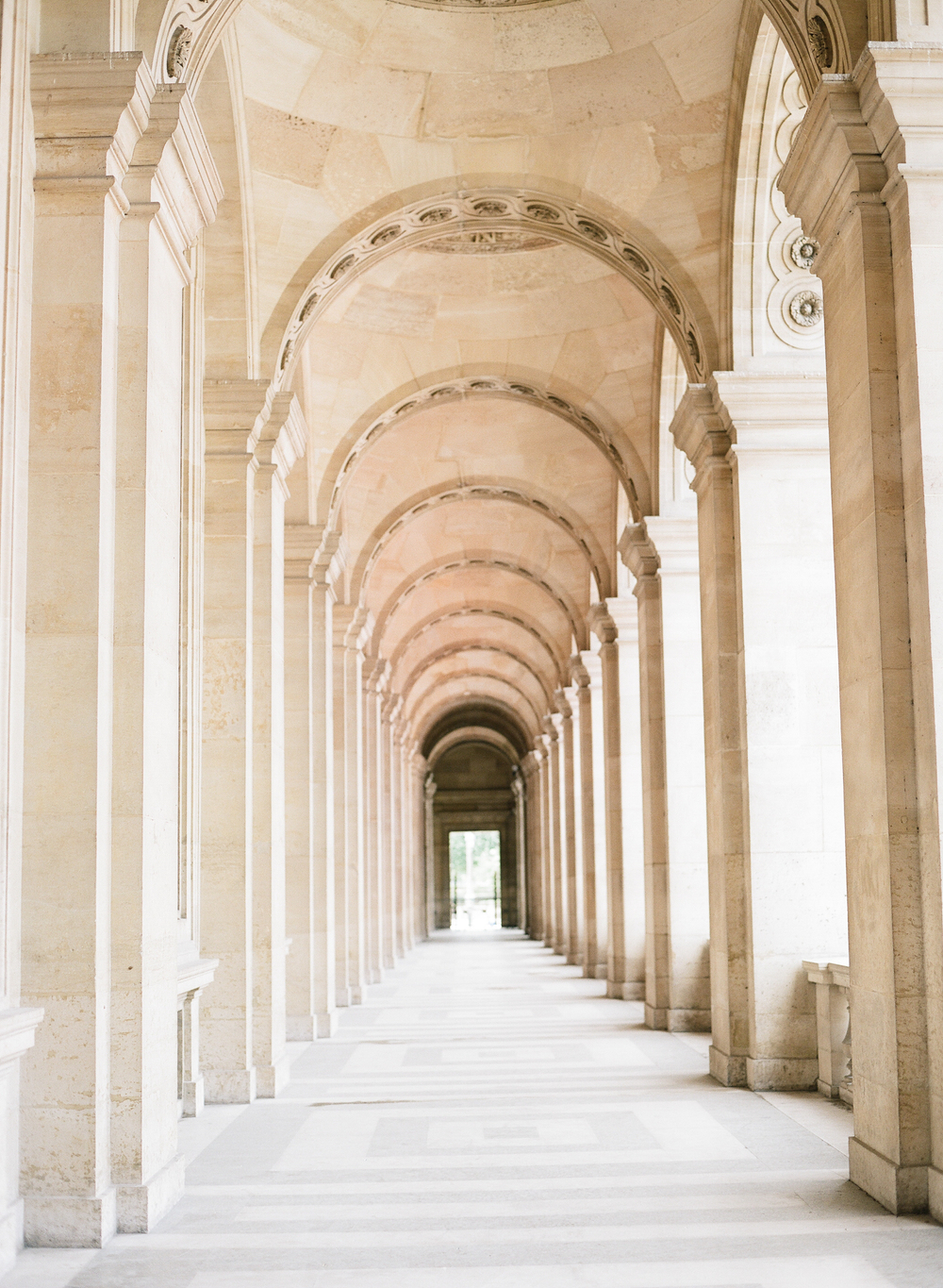 A perspective shot of an arched walkway in the Louvre; photo by Sylvie GIl