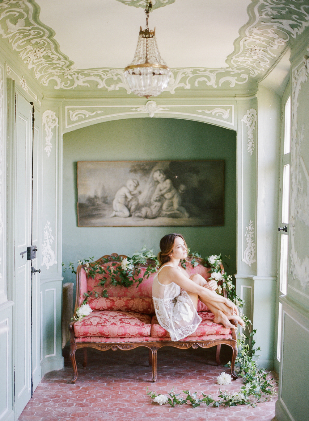 A boudoir session in an ornate room within the chateau with the bride before the wedding; photo by Sylvie Gil