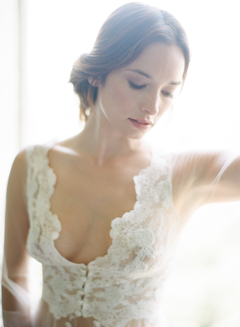 An intimate boudoir shot - the bride is dressed in a Claire Pettibone petticoat before the Provence wedding; photo by Sylvie Gil