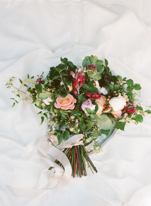 A colorful, rustic,bouquet designed by Fleurs d'Atelier; photo by Sylvie Gil