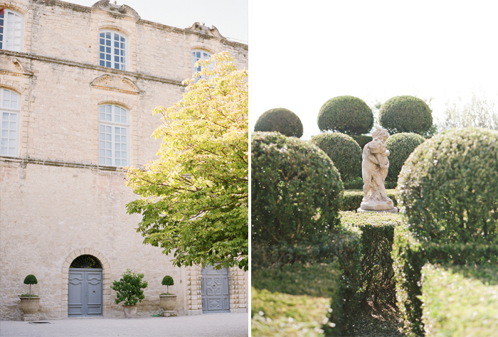 The grounds surrounding the rustic chateau in Provence - a stateau of two children stands in the gardens; photo by Sylvie Gil
