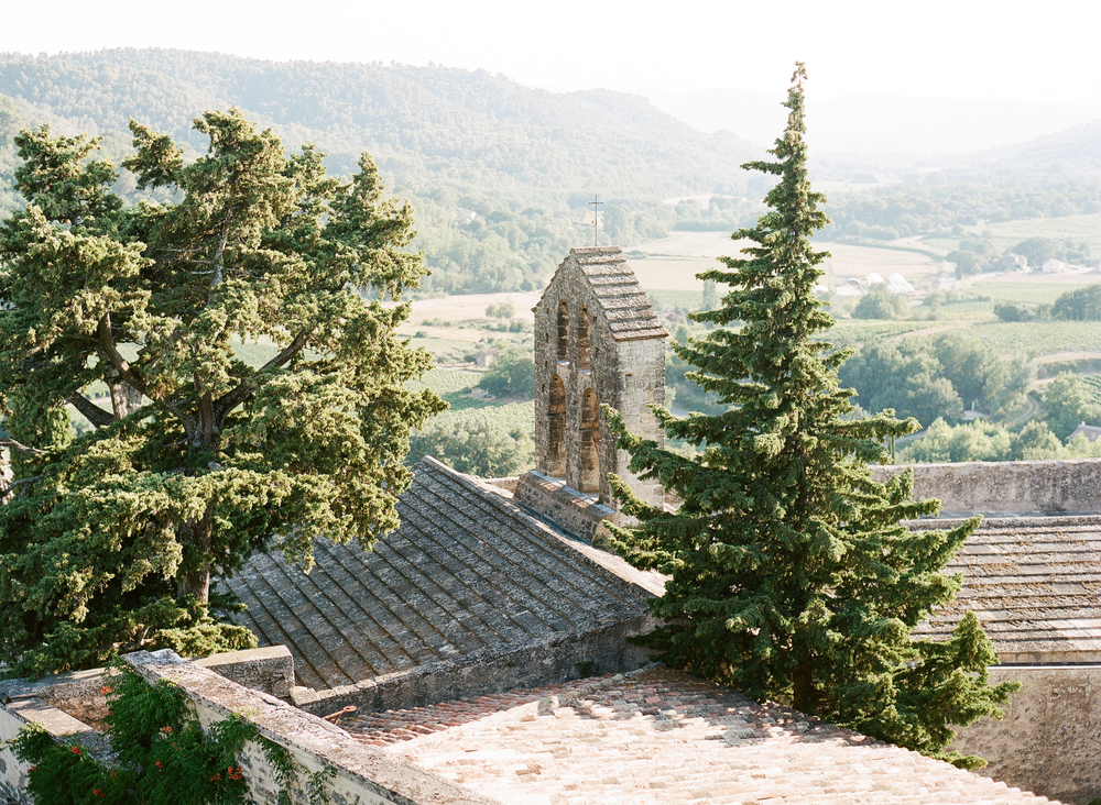 A view over the rooftops of the village and into the Provençal countryside, the perfect wedding destination; photo by Sylvie Gil