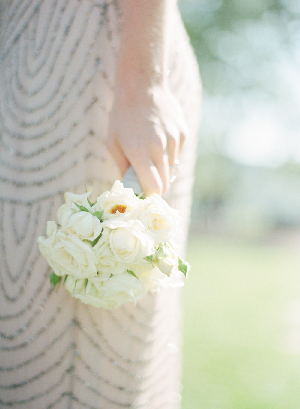 The bridesmaids bouquets are elegant white roses and peonies; photo by Sylvie Gil