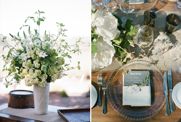 Glass plates, sprigs of rosemary and antique decor make a lovely shabby chic reception; photo by Sylvie Gil