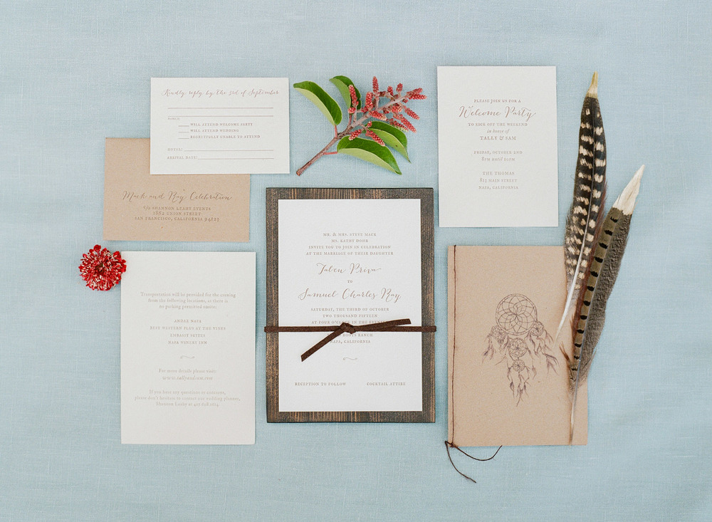 Tali & Samuel's invitation suite, themed with colorful florals, feathers, and dreamcatchers; photo by Sylvie Gil