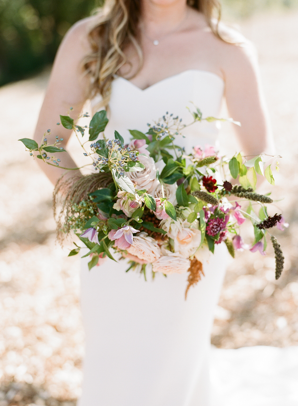 Tali's earthy, bohemian bouquet cascades during a couple shoot with Sylvie Gil