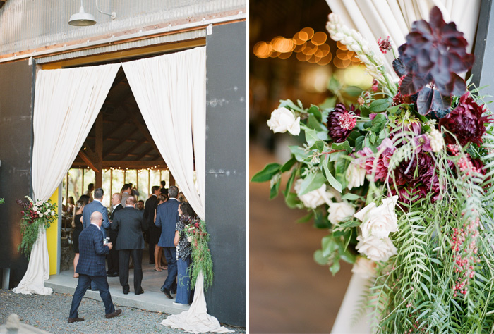 Curtains tied with equally eclectic floral ties featuring succulents mark the entry to the barn reception; photo by Sylvie Gil