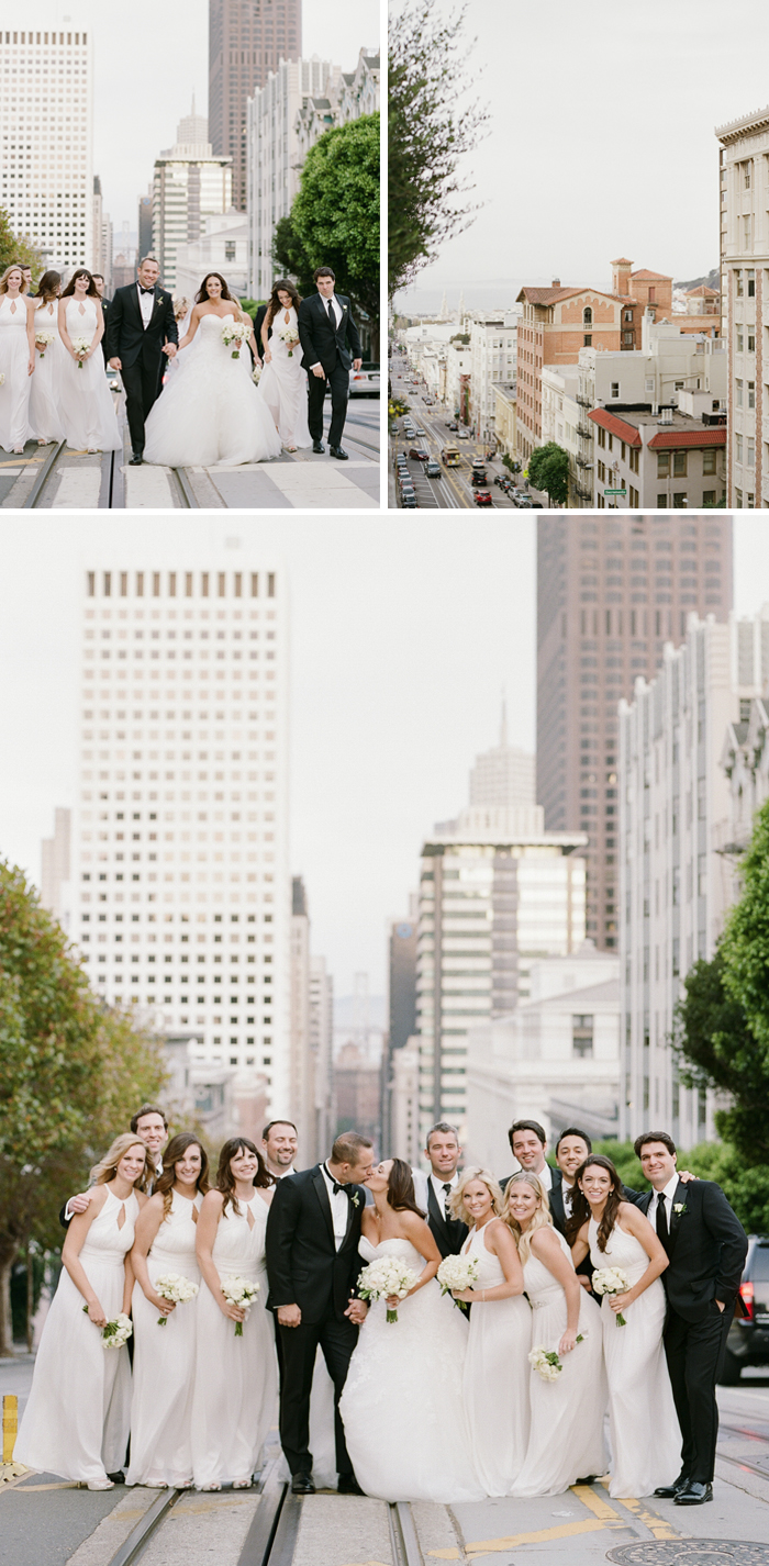 The bride and groom pose for a kiss with their bridal party in the middle of a San Francisco street; photo by Sylvie Gil