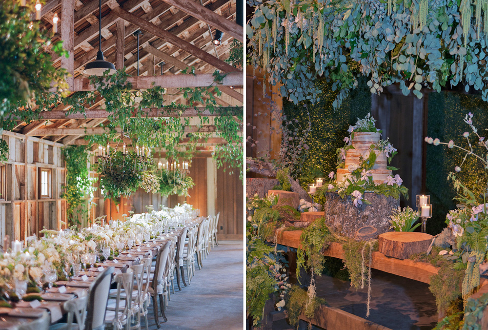 A three-tier naked cake adorned with flowers and moss sits atop a thick cut log, greenery hangs from the rafters of a barn at the indoor reception; photos by Sylvie Gil