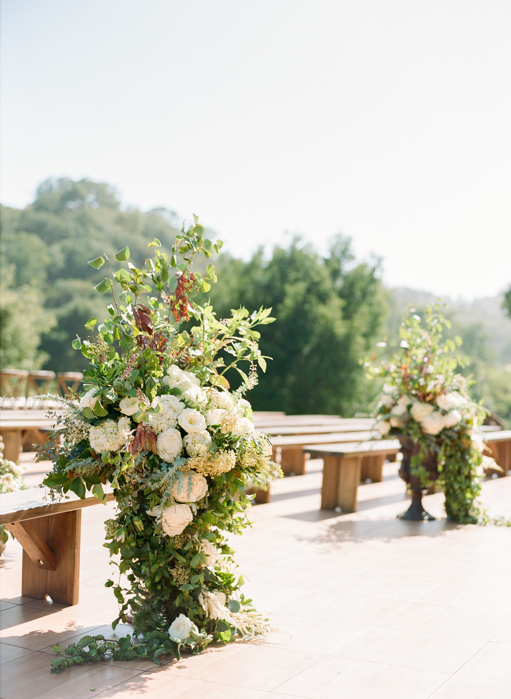 Cascading floral peony floral arrangements in ceremony area; Sylvie Gil Photography