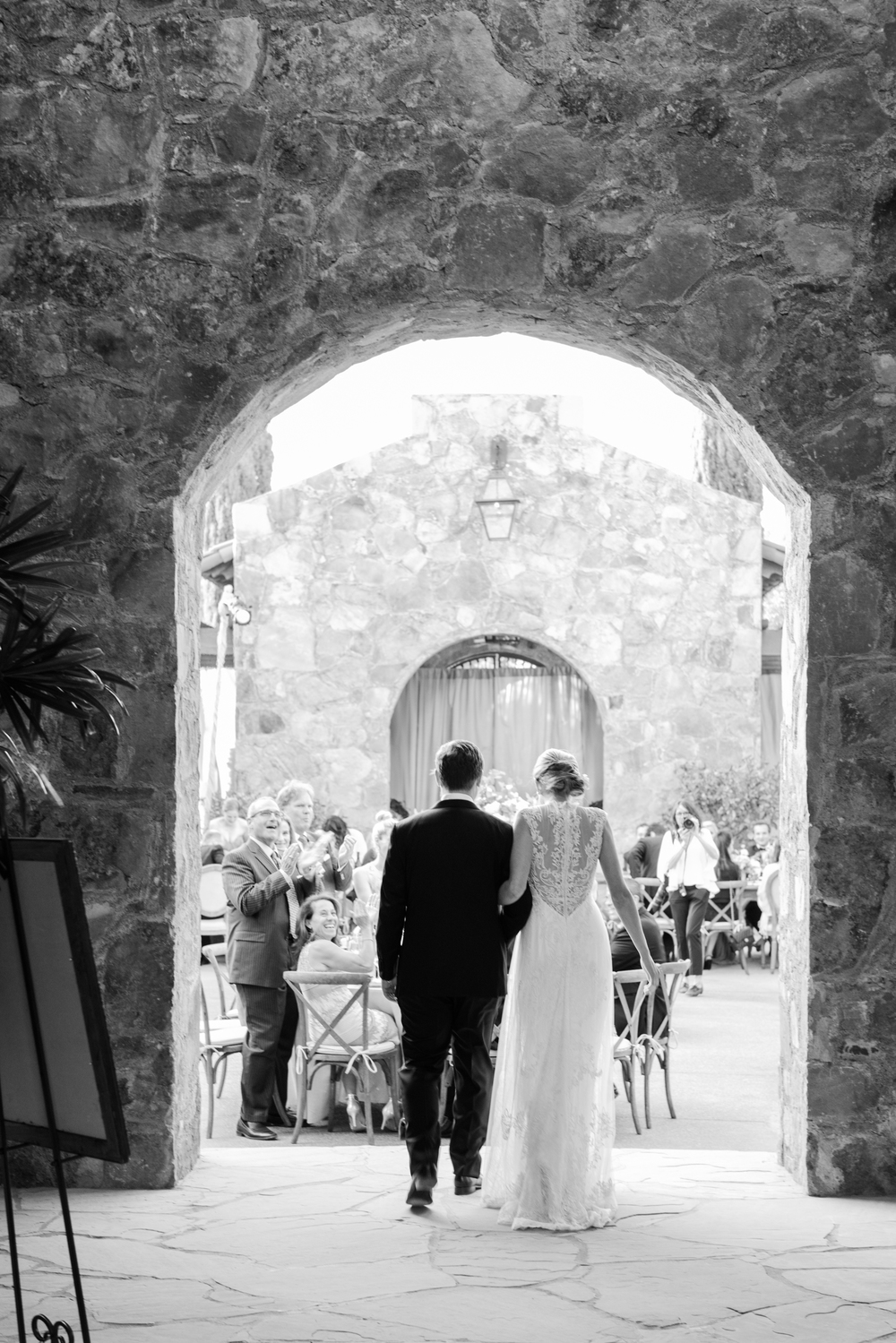 Bride and groom enter outdoor wedding reception in Calistoga Ranch; Sylvie Gil Photography