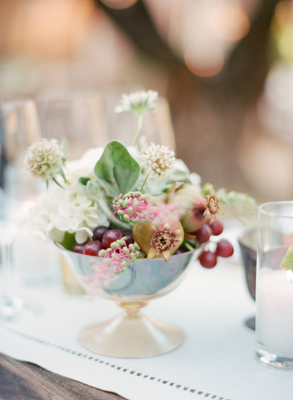 Fruit and floral centerpieces at the outdoor reception in Calistoga Ranch; Sylvie Gil Photography