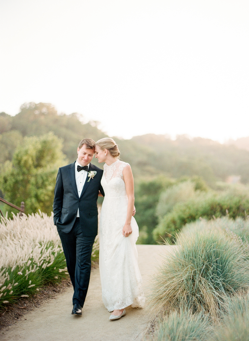 Bride and groom walk together in Calistoga Ranch during a couple session; Sylvie Gil Photography