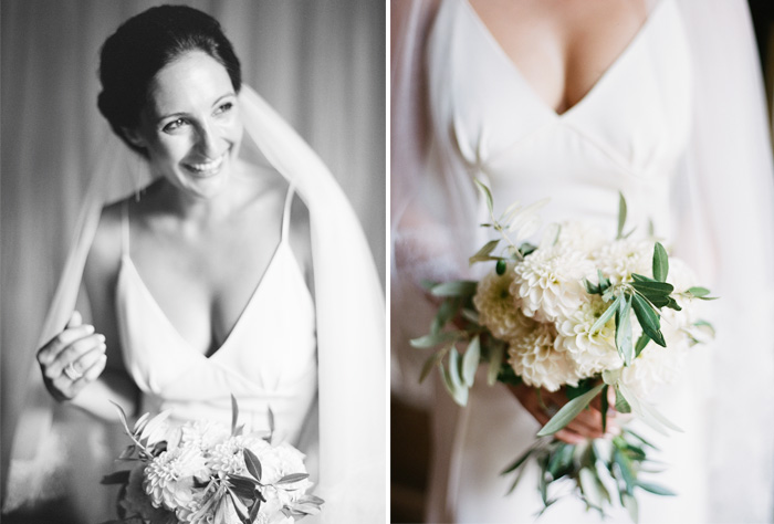 Bride wearing simple Celestina Agostino gown, holding rustic white dahlia bouquet; Sylvie Gil Photography
