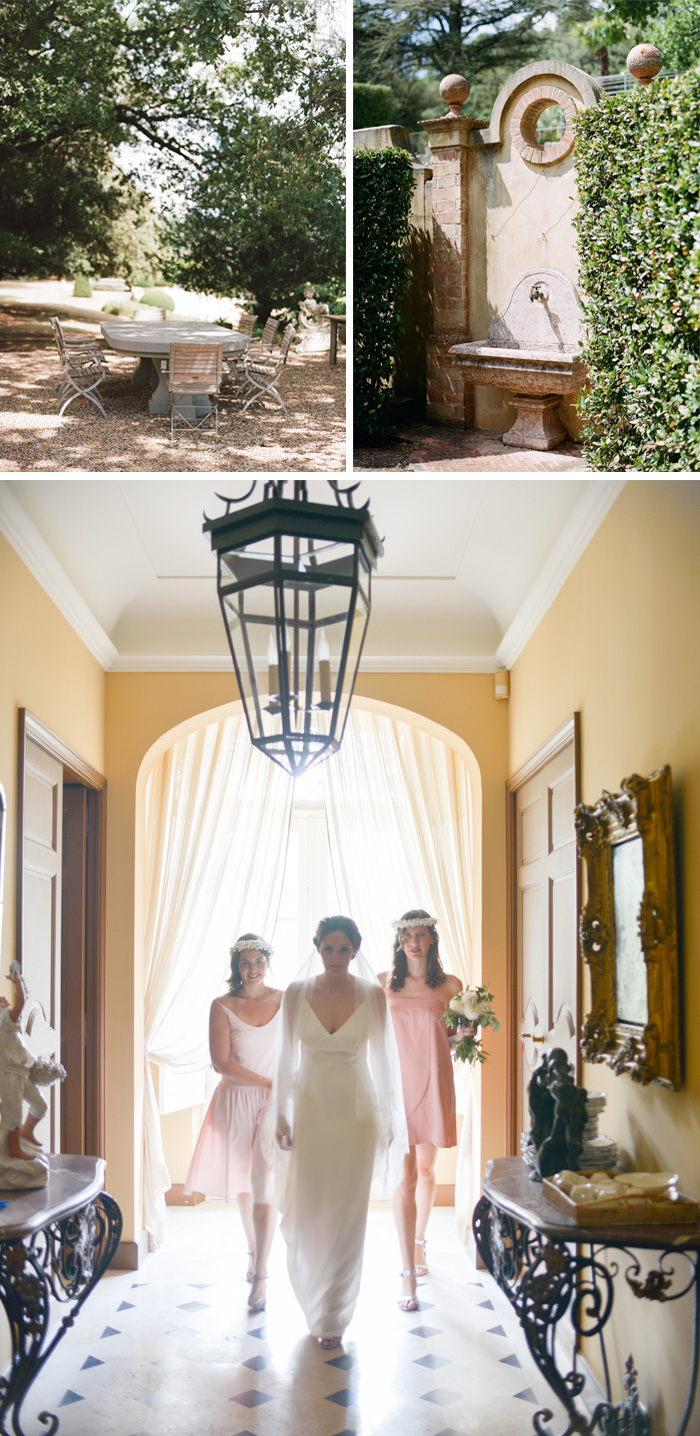 Gardens of Provençal chateau, bride walks down corridor with bridesmaids; Sylvie Gil Photography