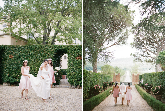 Bride and two bridesmaids walk through French gravel garden to ceremony; Sylvie Gil Photography