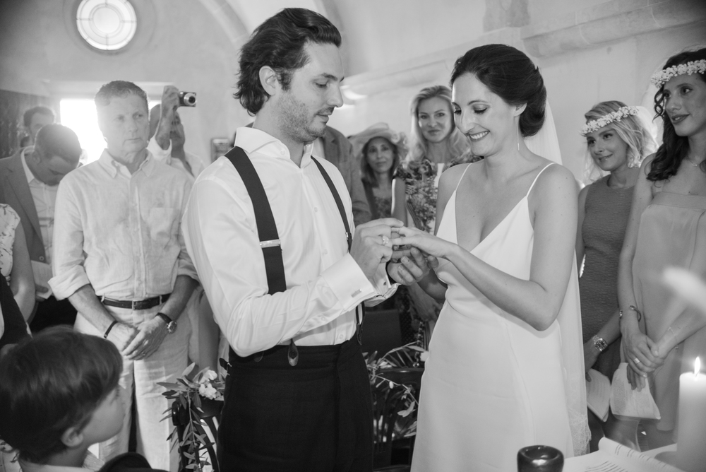 Bride and groom exchange rings during rustic chapel ceremony in Provence, France; Sylvie Gil Photography