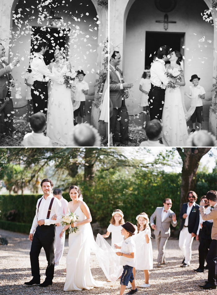 Guests throw rose petals as bride and groom exit the chapel, just married; Sylvie Gil Photography
