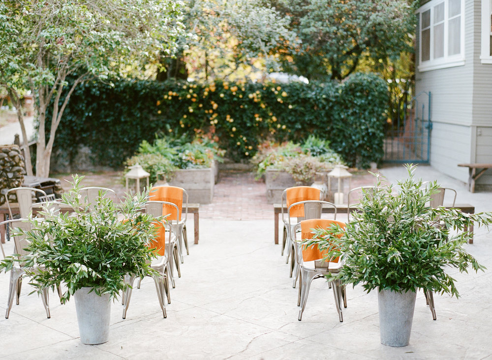 Concrete and metal details in the ceremony space, orange shawls for guests; Sylvie Gil Photographhy