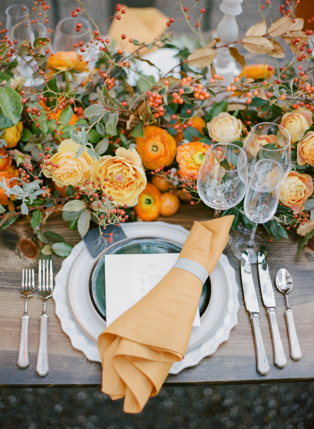 Fall outdoor wedding reception table setting with persimmon peony and ranunculus centerpiece; Sylvie Gil Photography