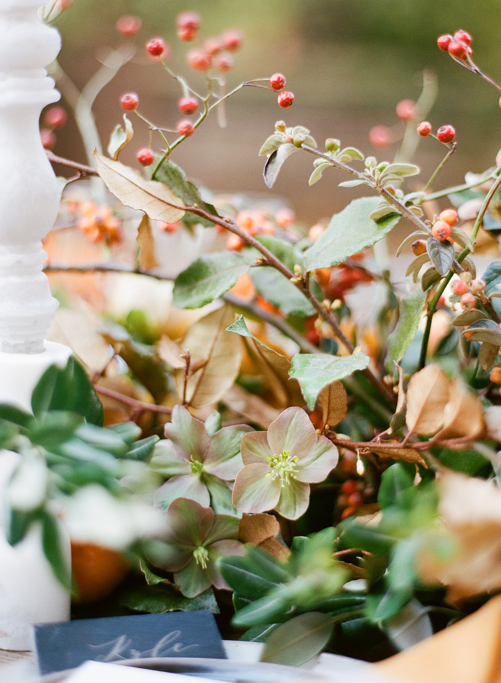 Rosehip and cotoneaster vines make up a stunning floral garland centerpiece; Sylvie Gil Photography