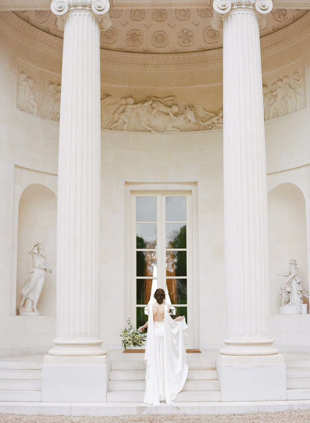 Greek architecture of Pavillon de la Musique and the bride in her Cortana gown with shoulder trains; Sylvie Gil Photography