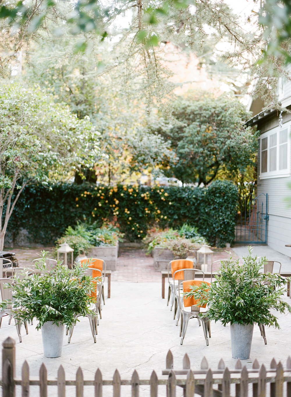 Backyard ceremony in St. Helena in November, orange accents, mixed wood and metal details; Sylvie Gil Photography