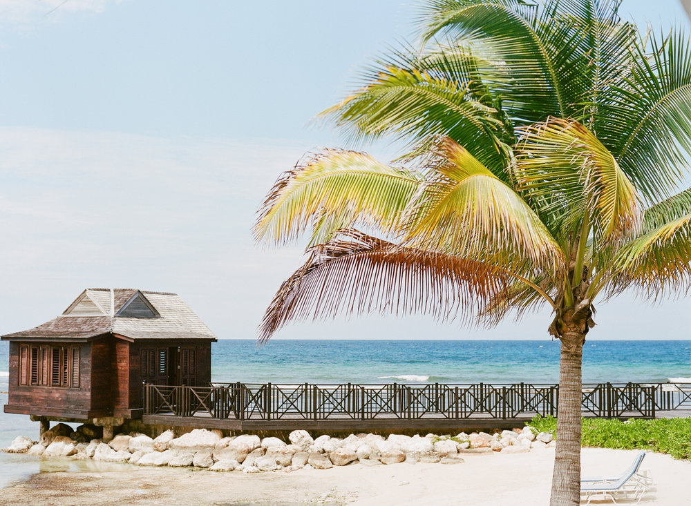 White sand beach and a beautiful cabana on the shore of Montego Bay, Jamaica; Sylvie Gil Photography