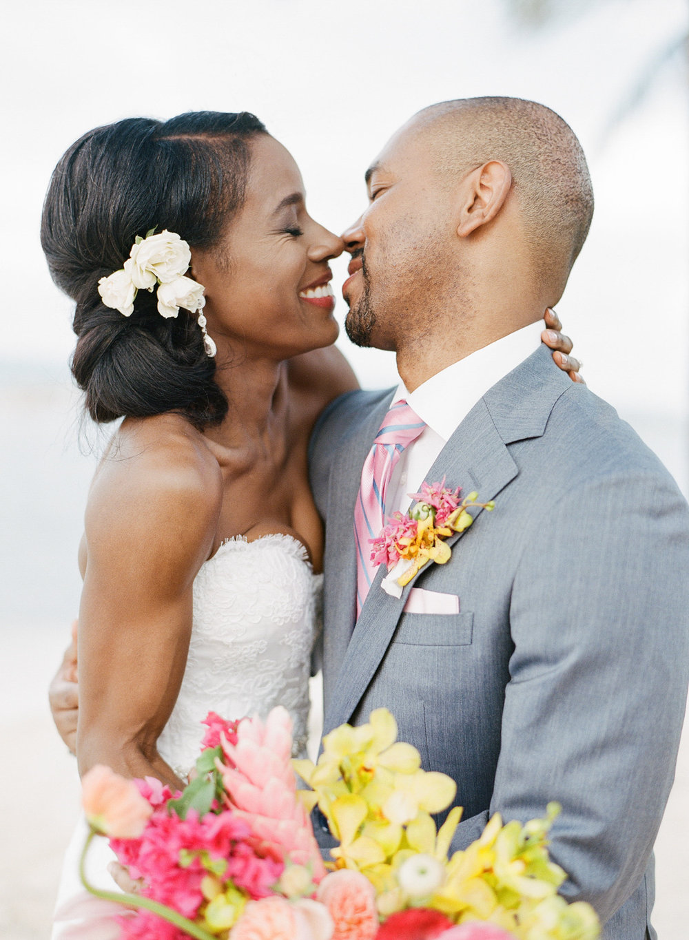 Bride and groom share a kiss after the ceremony in Montego Bay, Jamaica; Sylvie Gil Photography