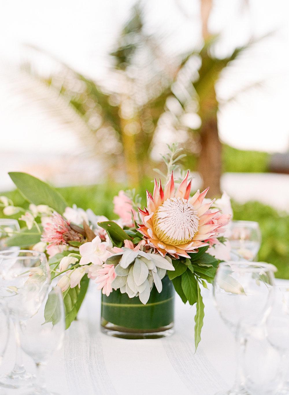 Exotic tropical blooms centerpiece at Montego Bay wedding reception; Sylvie Gil Photography