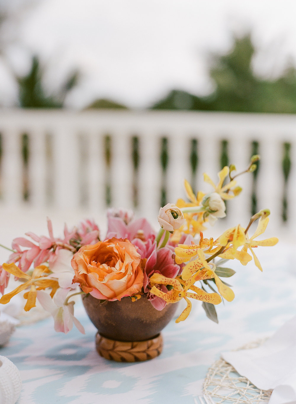 Bright, tropical orchid and peony arrangements for Montego Bay reception tables; Sylvie Gil Photography
