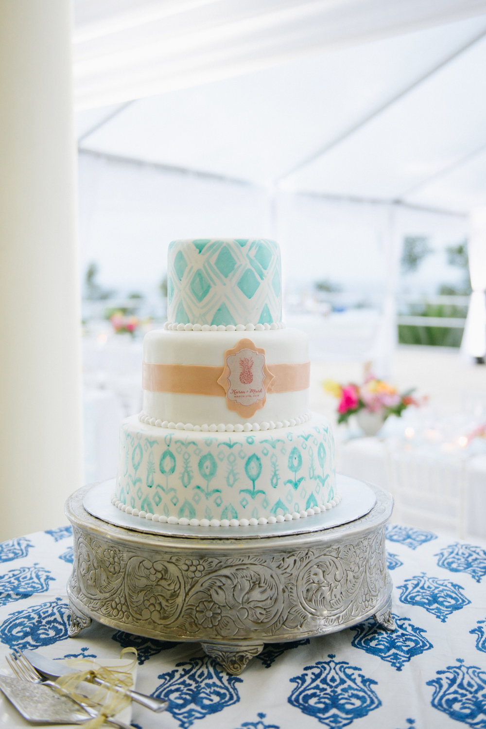 Teal ikat design for three tier cake with pineapple motif; Sylvie Gil Photography