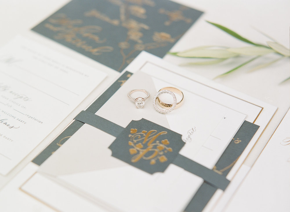 Maddy & Patrick's Papellerie invitation suite and wedding rings; Sylvie Gil Photography