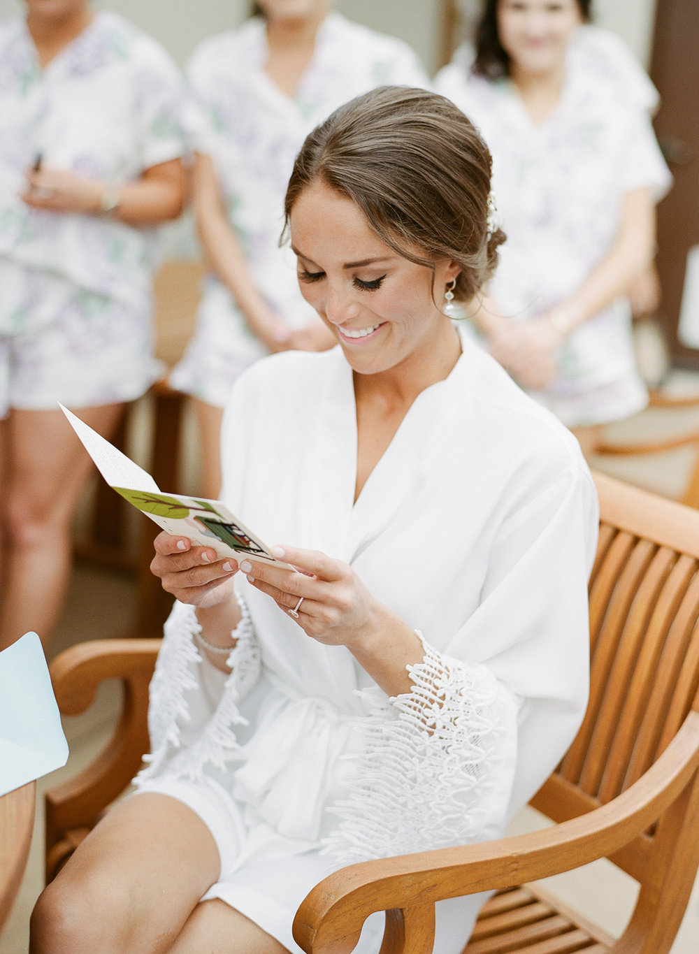 Bride getting ready, reading a letter from the groom before the Vintage Estates wedding; Sylvie Gil Photography