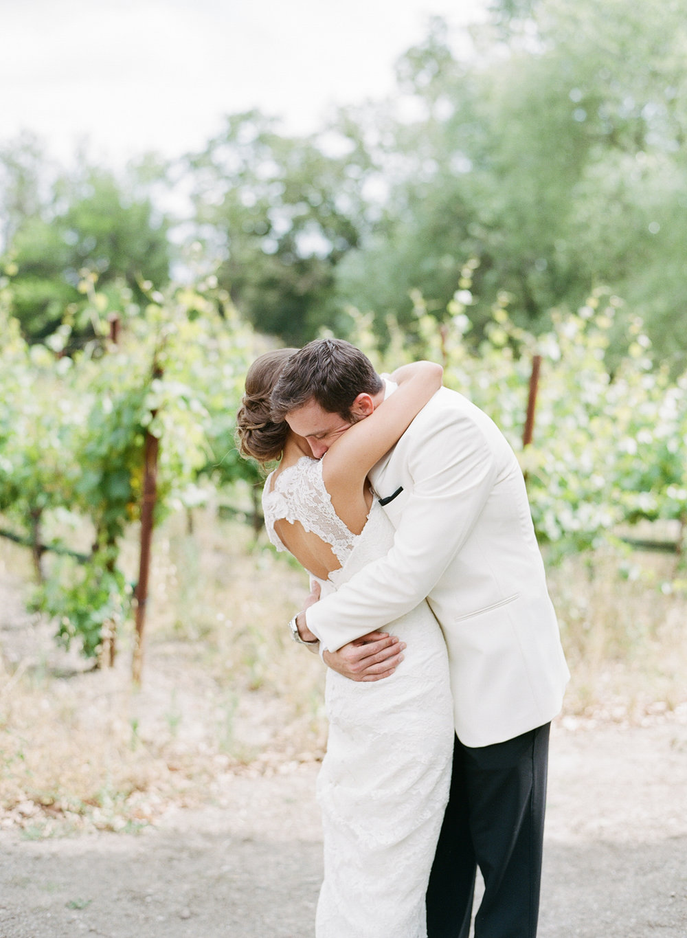 The bride and groom share a tender moment during the first look; Sylvie Gil Photography