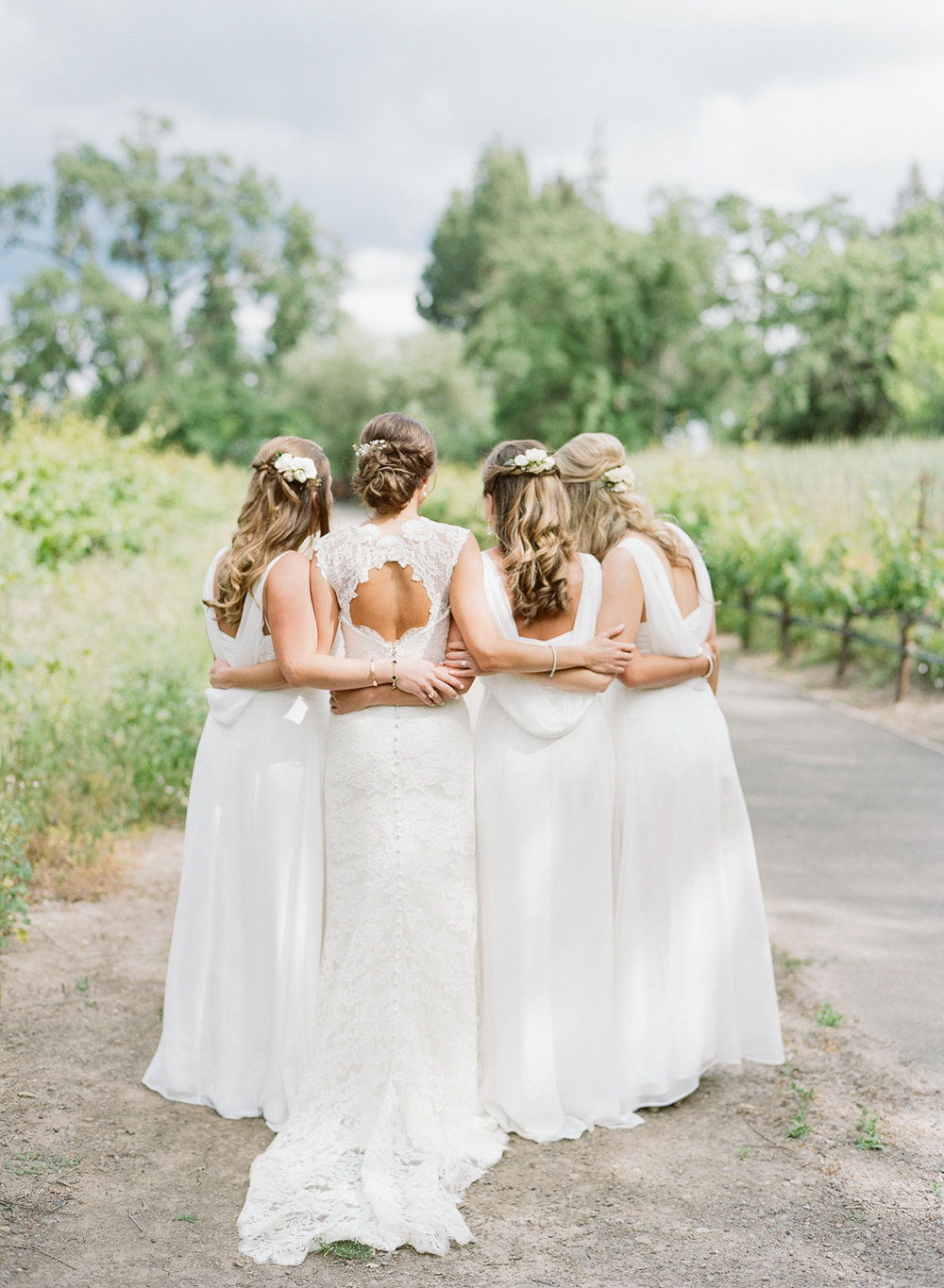 Bride with three bridesmaids in classic white Monique Lhuillier gowns; Sylvie Gil Photography