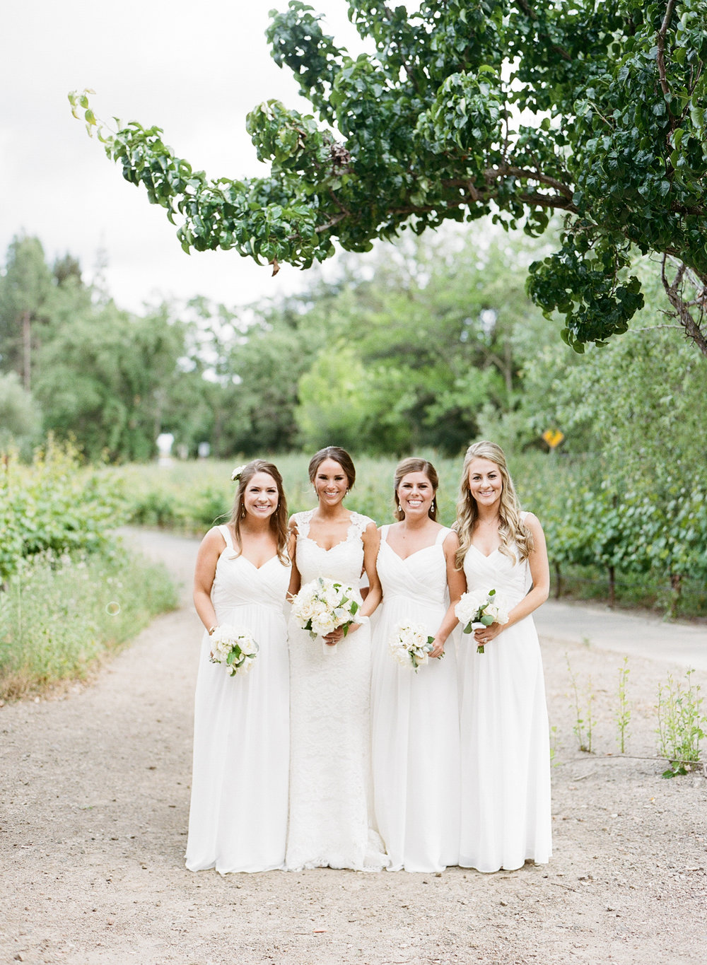 Bride and three bridesmaids before the Vintage Estates, Yountville, CA wedding; Sylvie Gil Photography