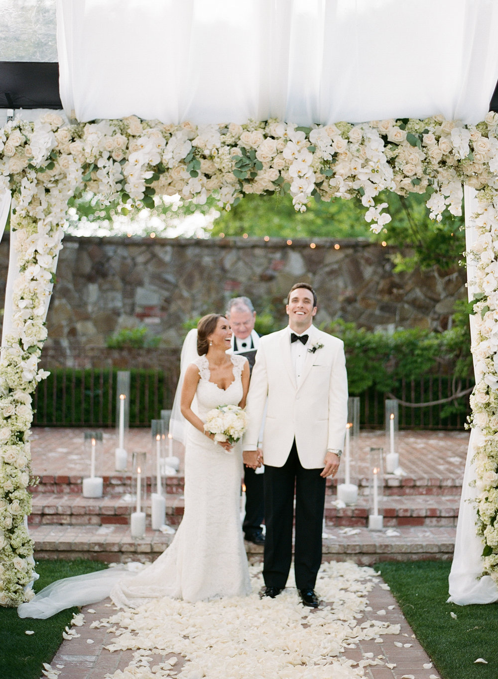 Bride and groom walk up the aisle just married after ceremony in Yountville, Napa Valley; Sylvie Gil Photography