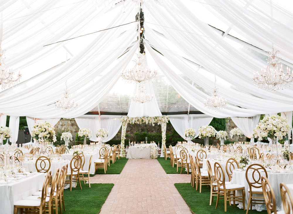 White table settings with gold chairs in tent with white awning for reception; Sylvie Gil Photography