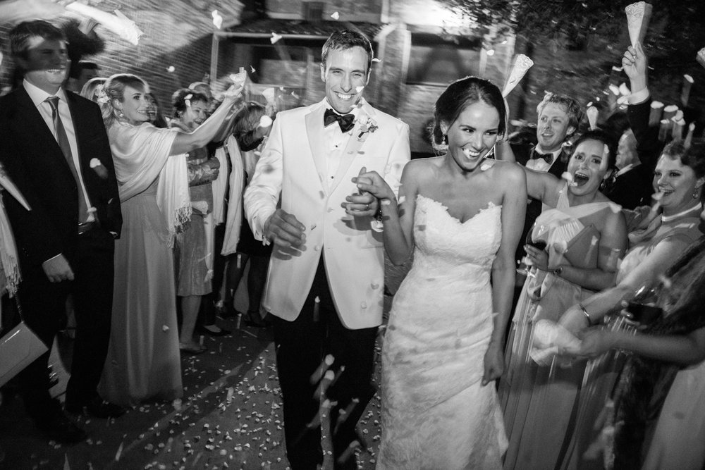 Guests shower the bride and groom in confetti outside Vintage Estates pavilion; Sylvie Gil Photography