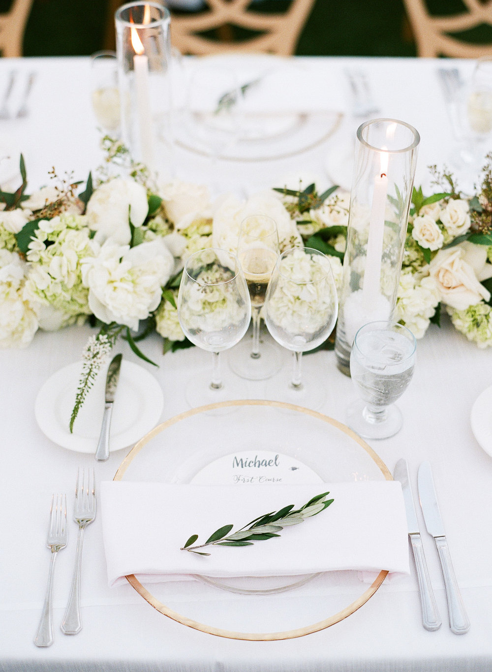 White floral table runners with gold trimmed table settings; Sylvie Gil Photography